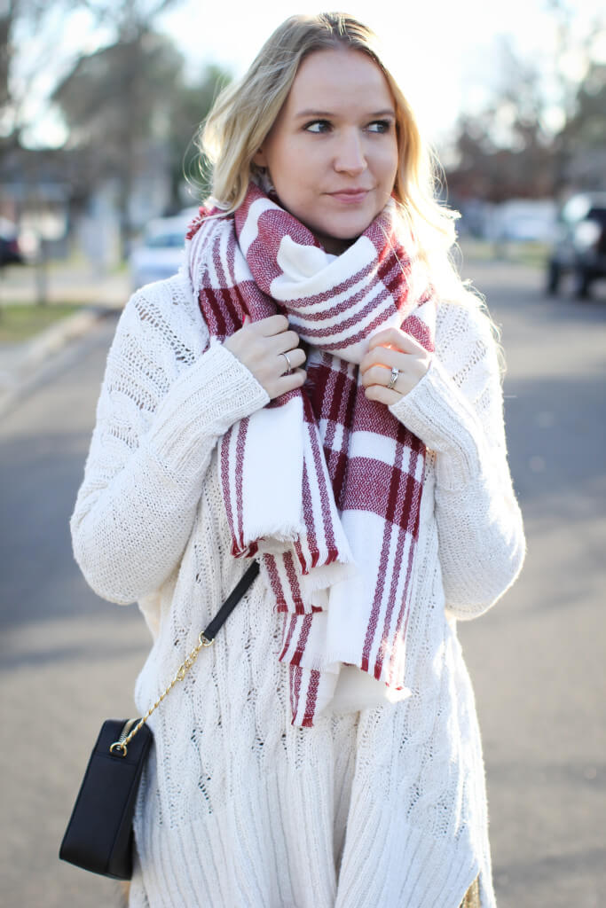 Sweater and plaid scarf